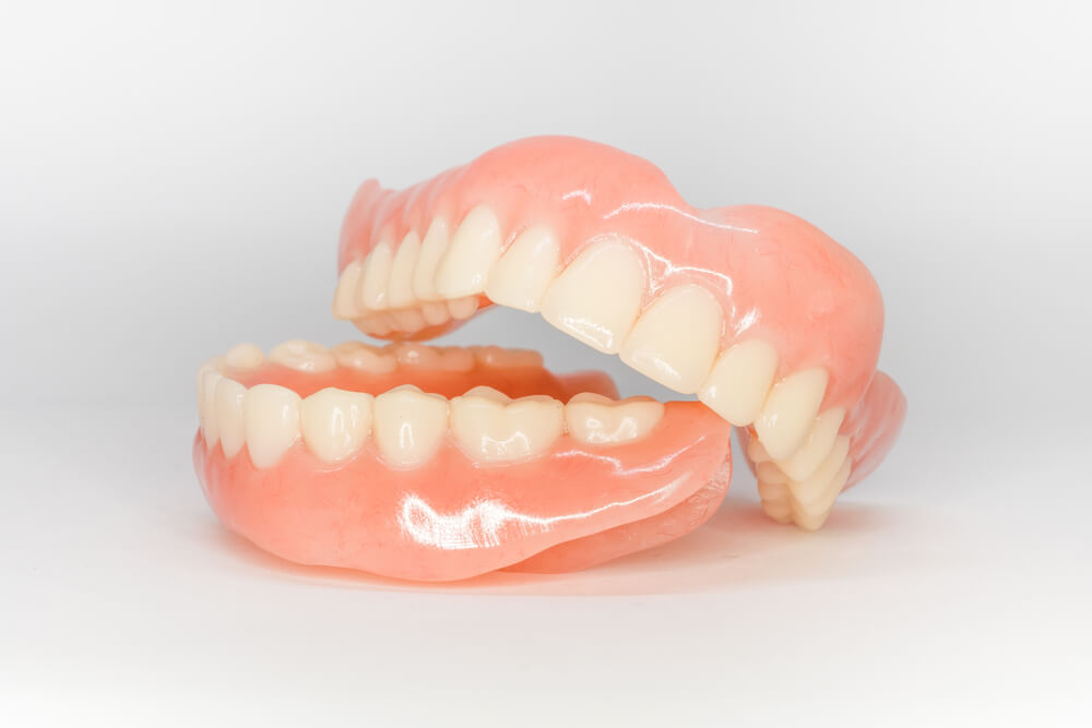 set of dentures on isolated background