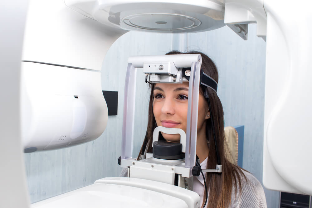 younger female being examined with digital x-ray machine
