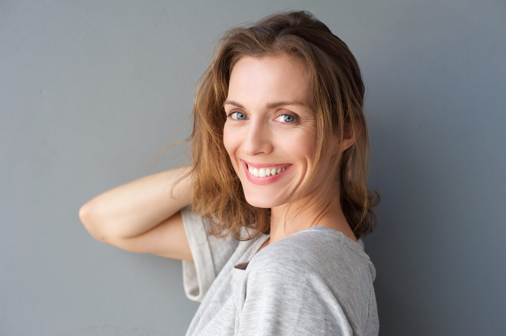 smiling mature woman after full-mouth reconstruction